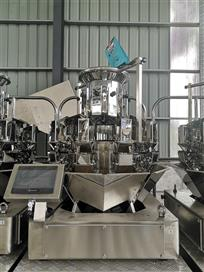 The working principle of Multi head weigher